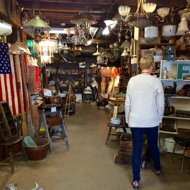 Woman looking at Habitat for Humanity Restore items