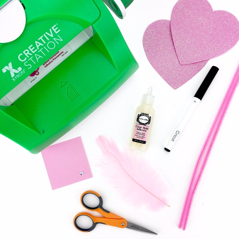 xyron creation station and paper supplies for valentine pink flamingo
