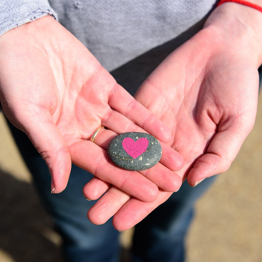 Woman holding heart rock