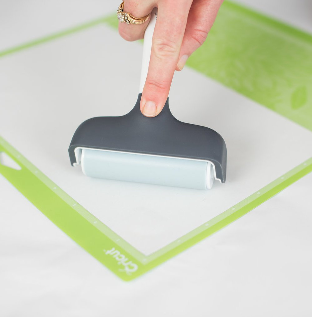 use the Cricut Brayer to give the iron on a strong grip to the mat