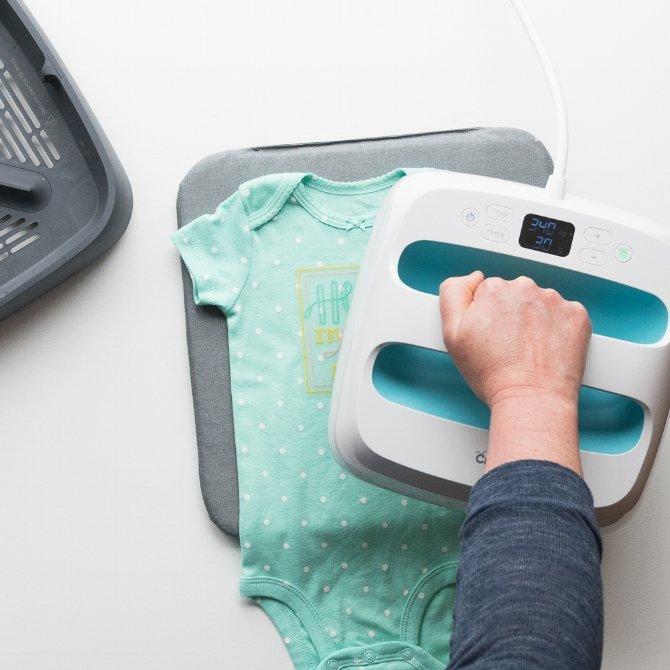 apply iron-on design to front of onesie