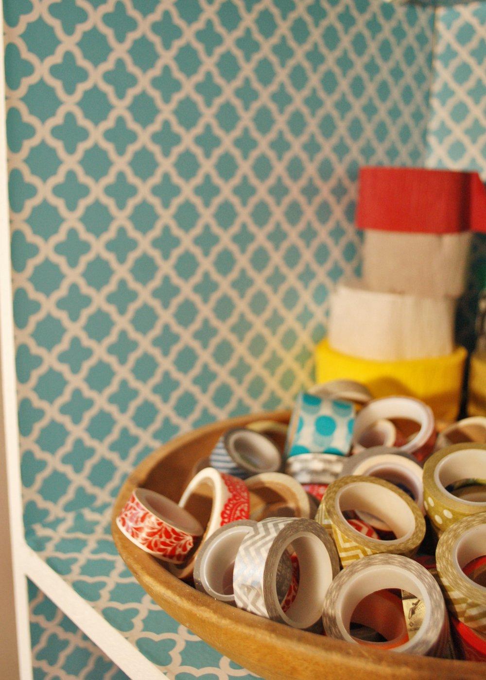 washi tape in bowl on bookshelf
