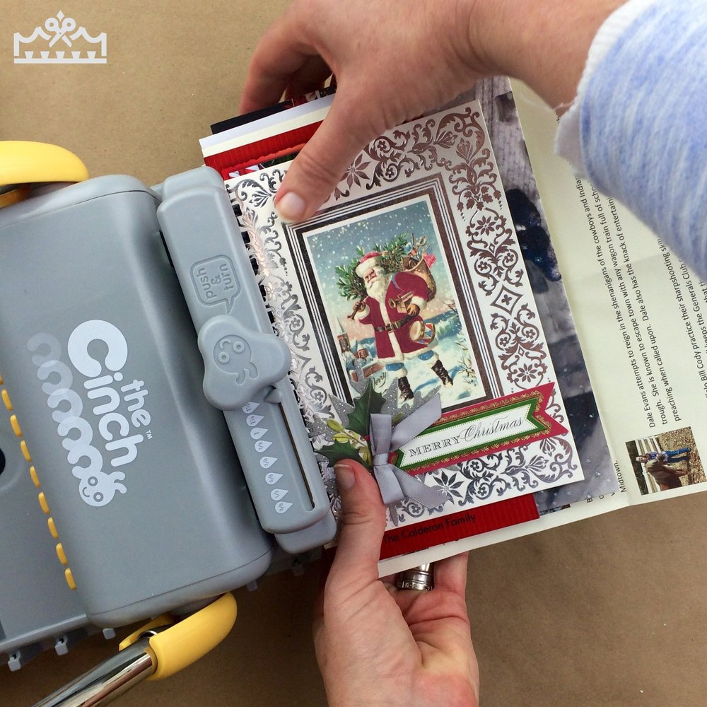 a woman creating albums using Christmas cards