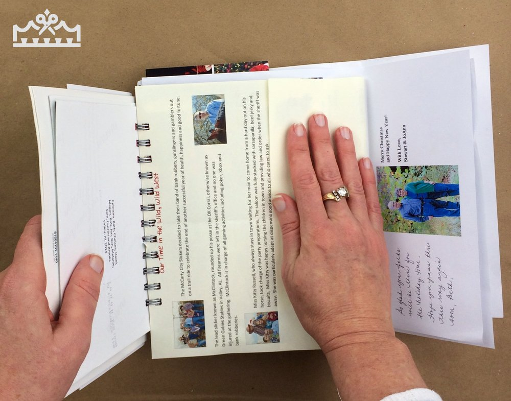 woman folding letters into thirds so they fit nicely inside the mini album