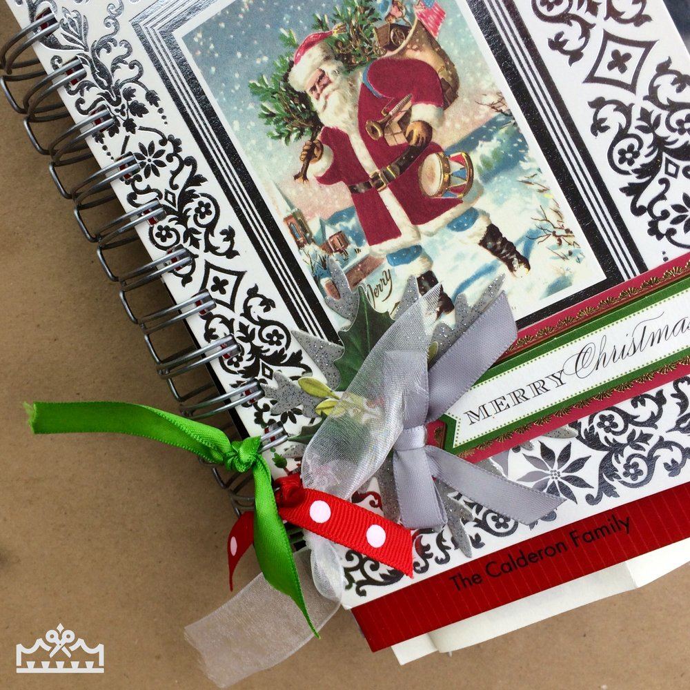 small pieces of ribbon tied to the binding wires of Christmas card mini album