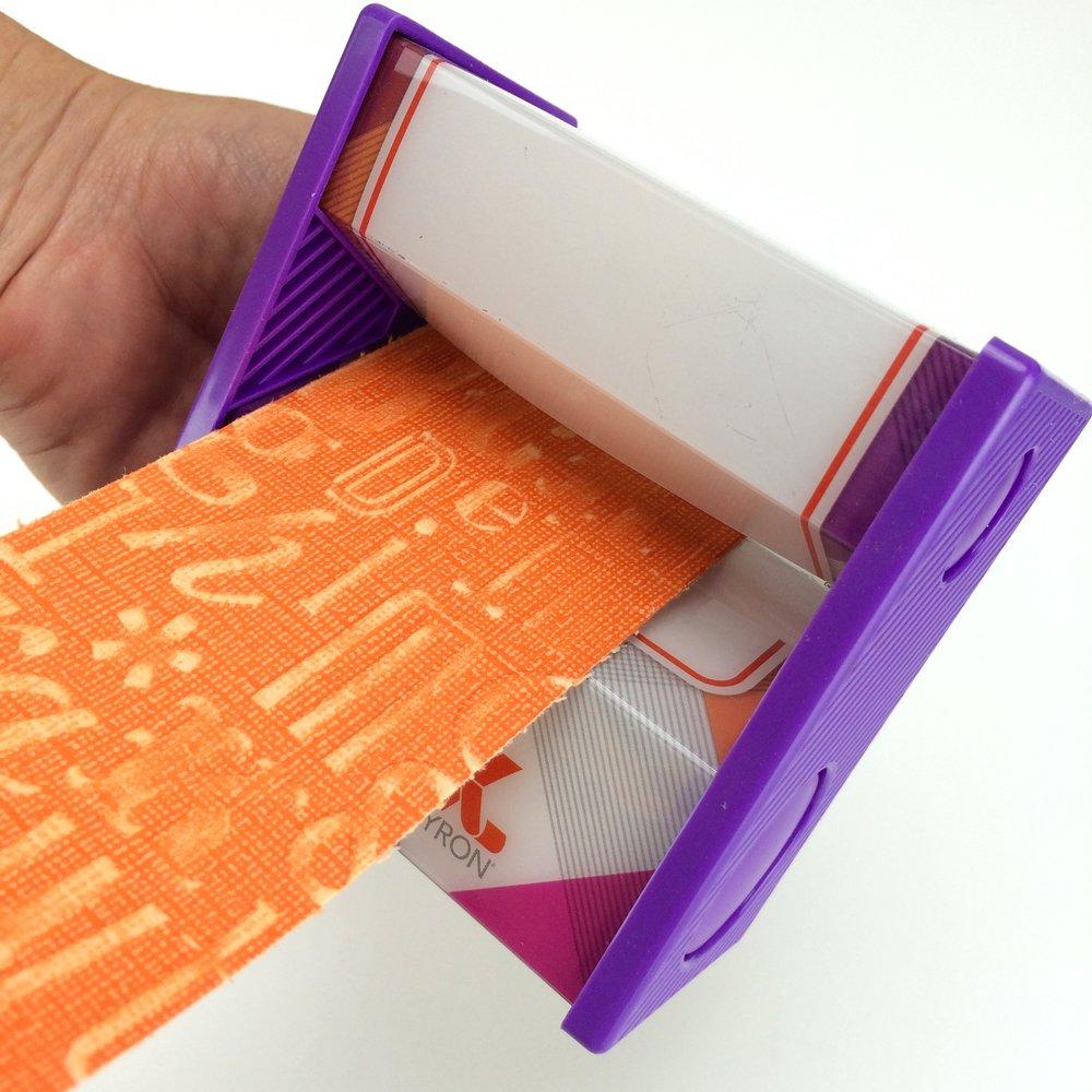 run scrapbook paper through xyron sticker maker