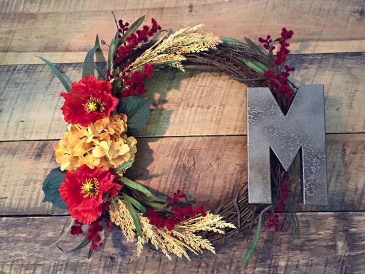 rustic flower wreath with metal monogram letter