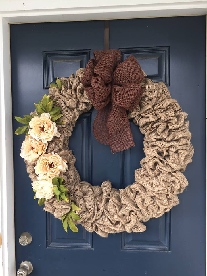 brown burlap wreath with white flowers and bow