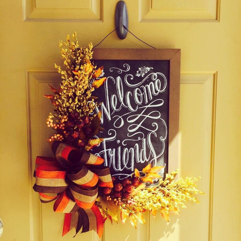 chalkboard wreath with harvest flowers and bow