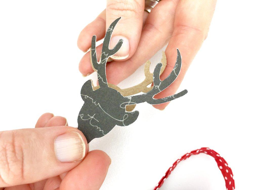 add paper deer embellishment to chipboard embellishment