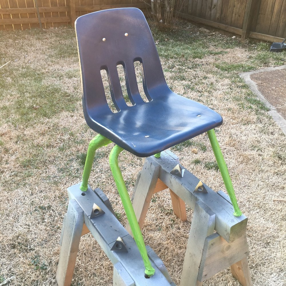 tape off the chair legs to prep for paint