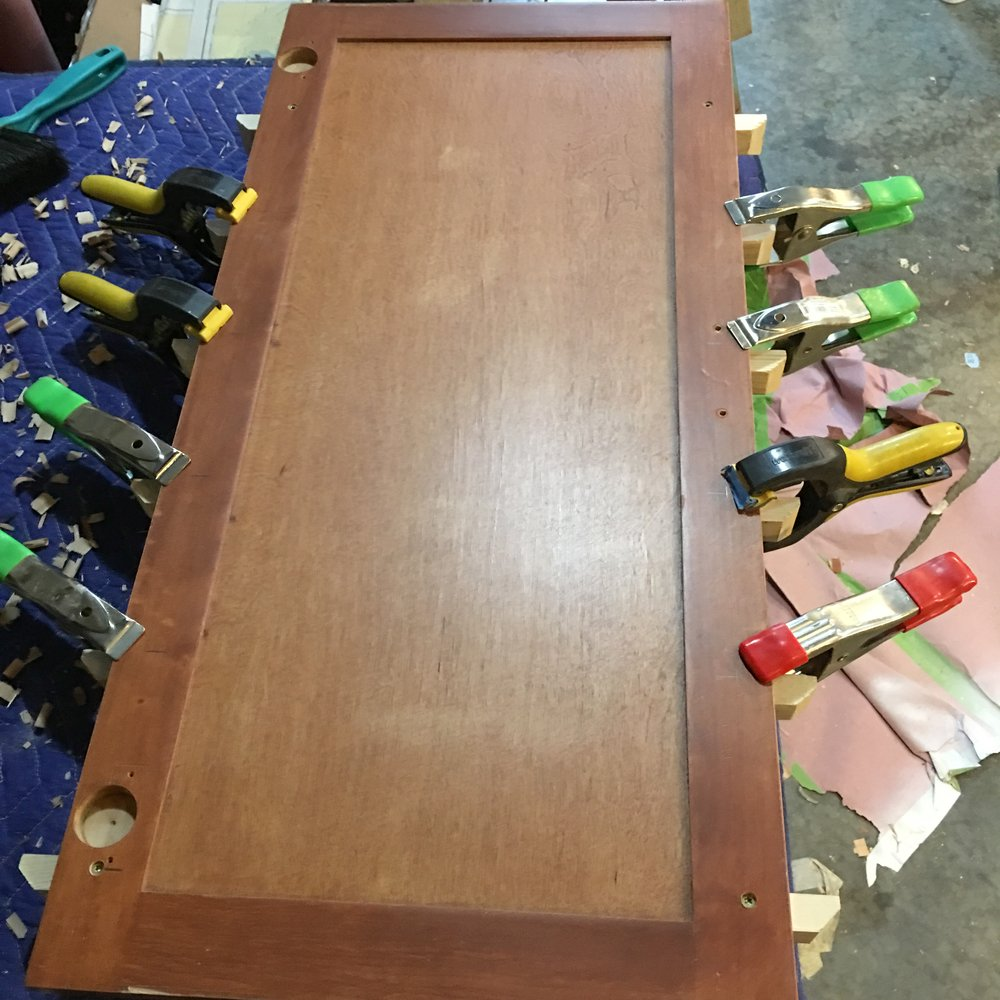 use clamps to hold boards in place for cabinet shelf
