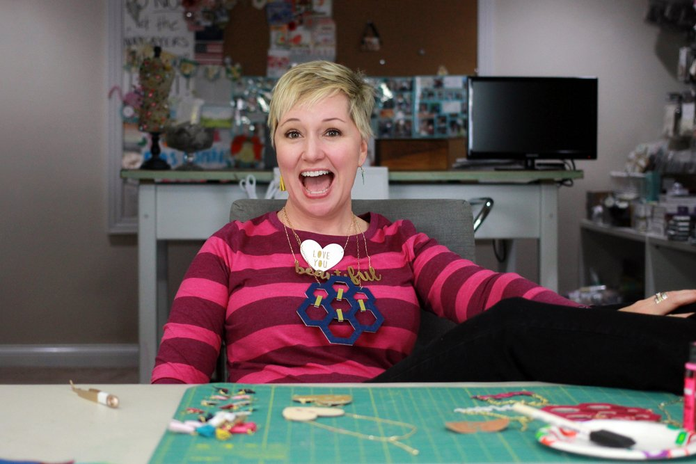 Beth Kingston wearing custom made necklaces with cricut