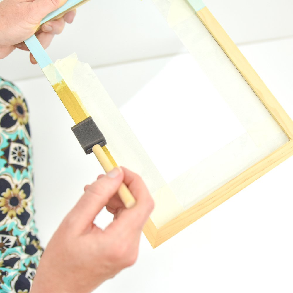 Apply several coats of gold paint to frame