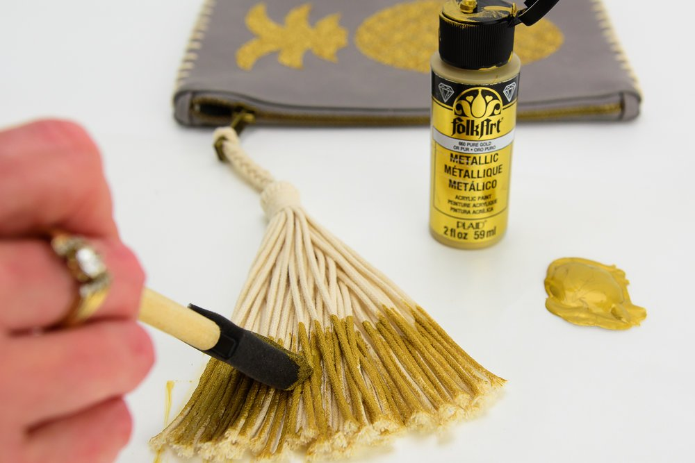 add gold paint to tassel