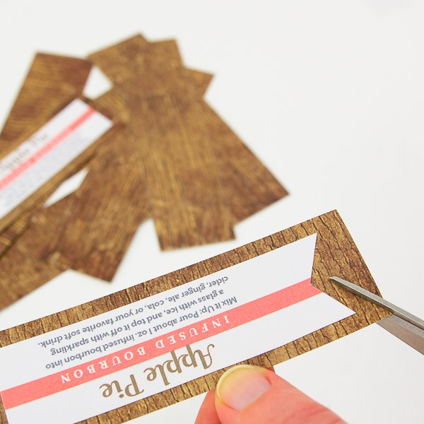 cut patterned paper and add tag to patterned paper
