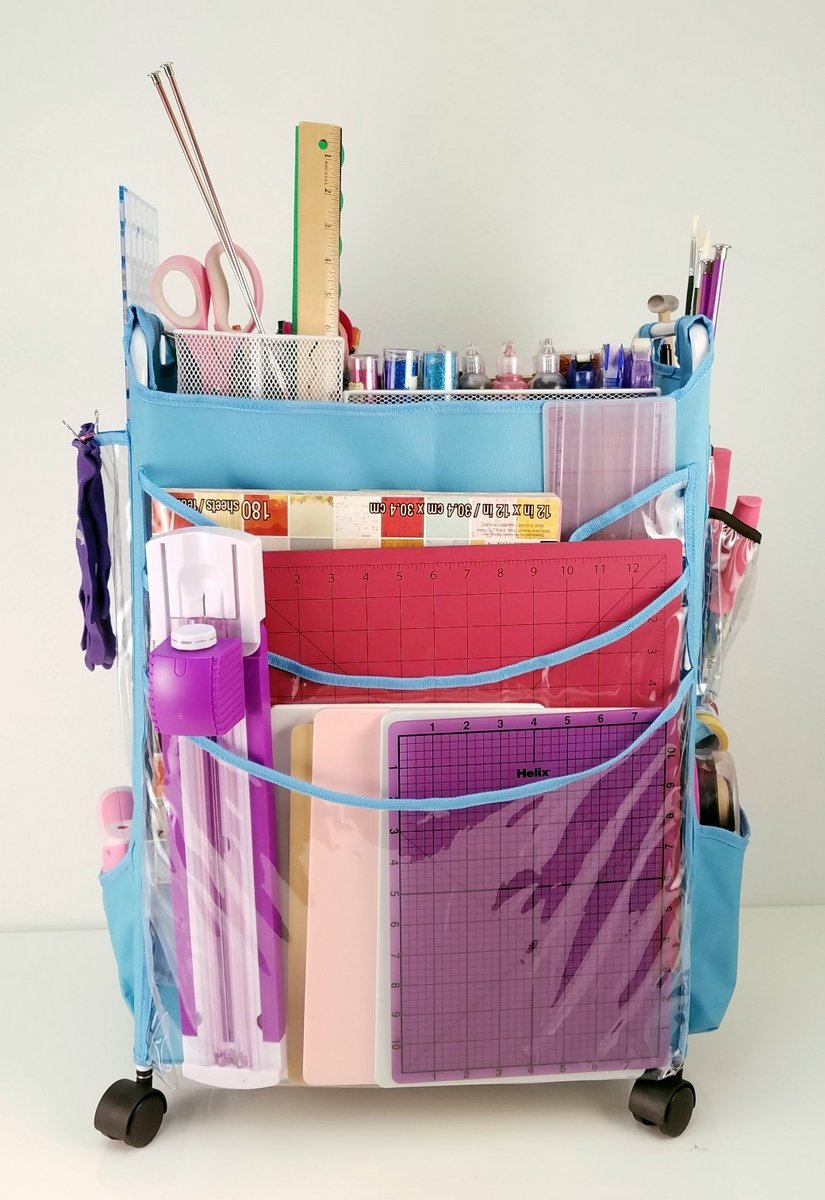craft cart filled with paper trimmers and cutting mats