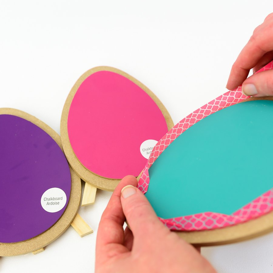 remove the stickers from the wooden eggs and wrap the edges with washi tape