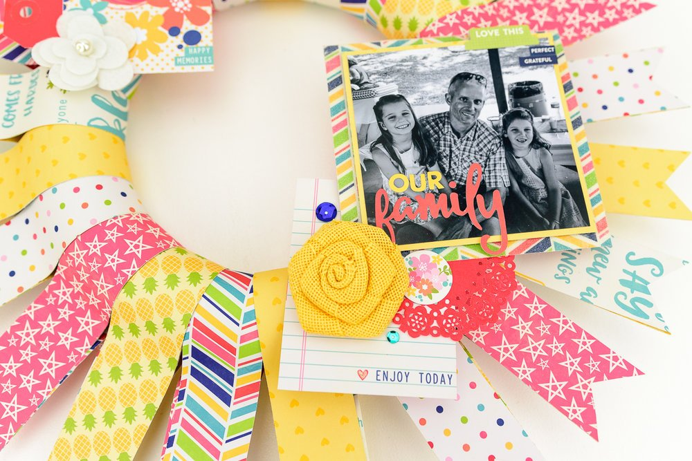 paper wreath with fabric flowers and photos
