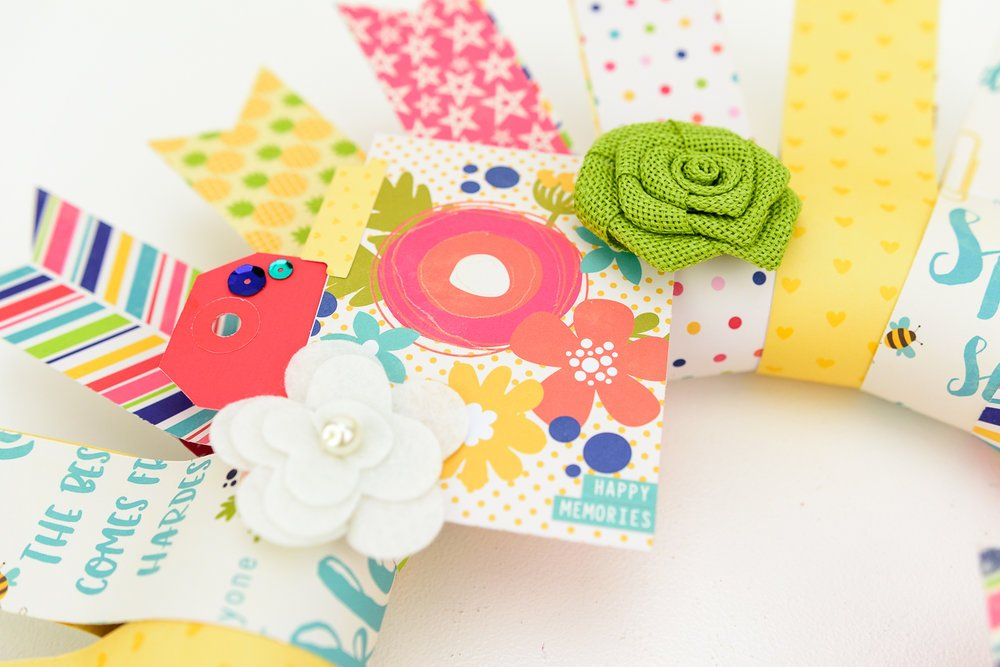 bright paper wreath with fabric flowers