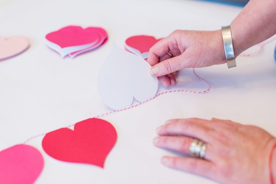 open heart card and lay the twine across the fold