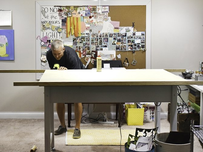 man working on drafting table