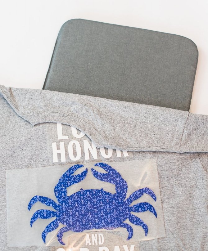 lay your t-shirt over cricut easypress mat and place your iron ons
