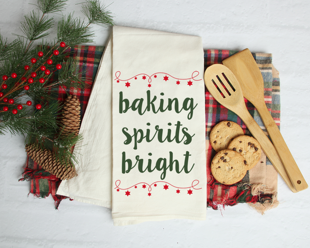 Christmas tea towel with wooden spoons and chocolate chip cookies