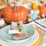 adhere the place card to the center of the cornucopia with hot glue