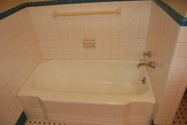 empty unused bathtub in bathroom