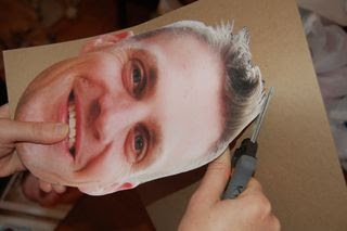 photo adhere to cardboard being cut out