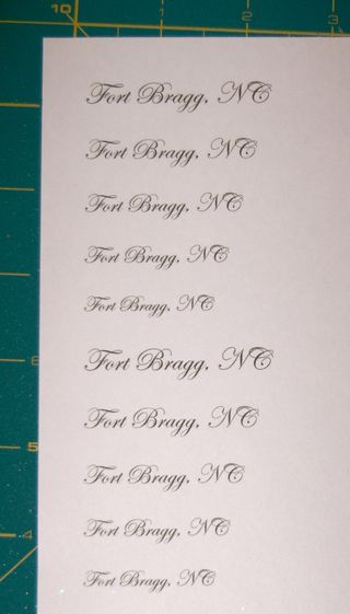 sheet of paper with Fort Bragg, NC wording on cutting mat