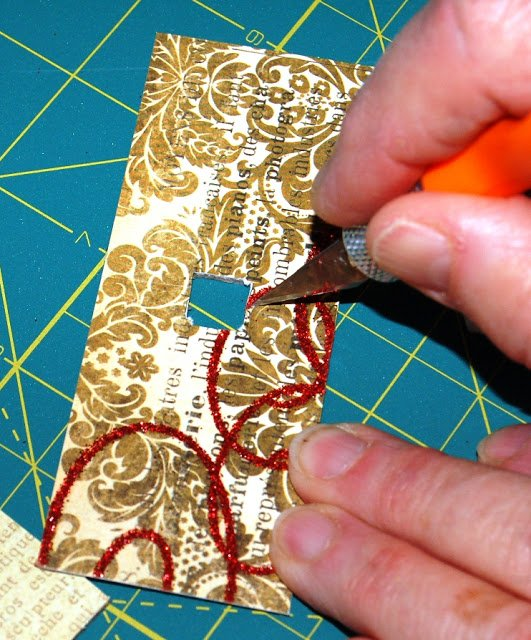 woman's hand cutting with x acto knife on Melissa Frances Chipboard House