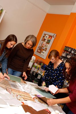women looking at scrapbooking paper