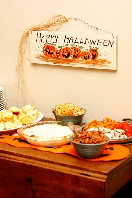 happy halloween sign and food on table