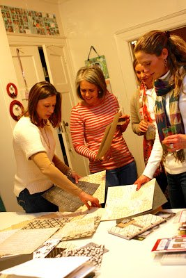 women looking at scrapbooking paper