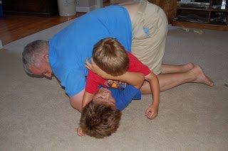 man wrestling with kids