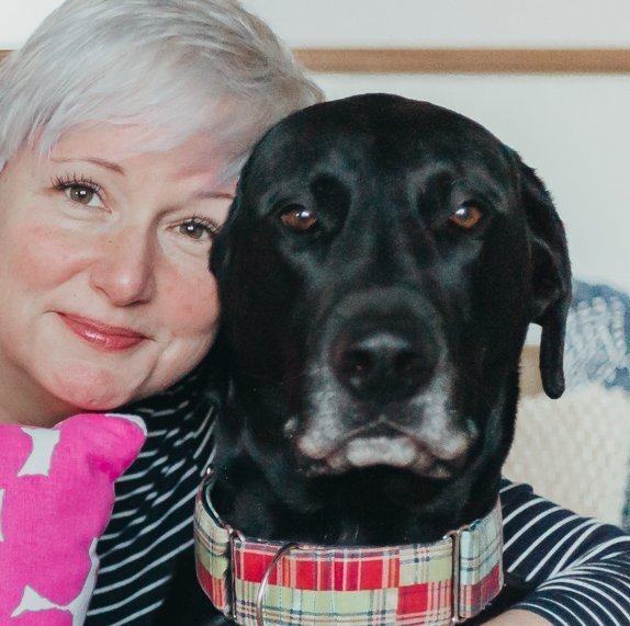 woman hugging big black dog