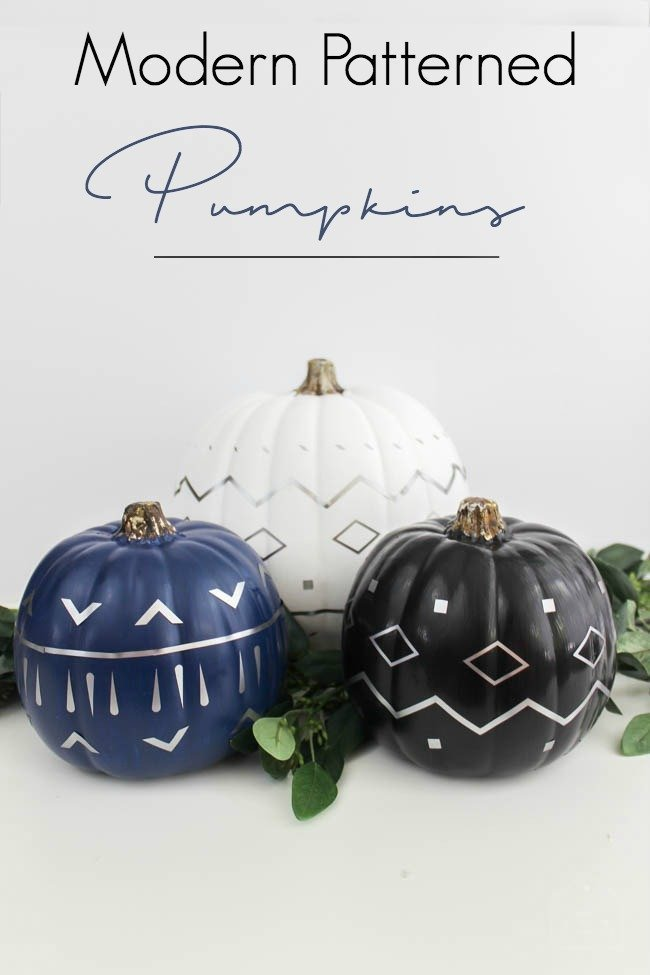 blue black and white painted pumpkins with silver designs