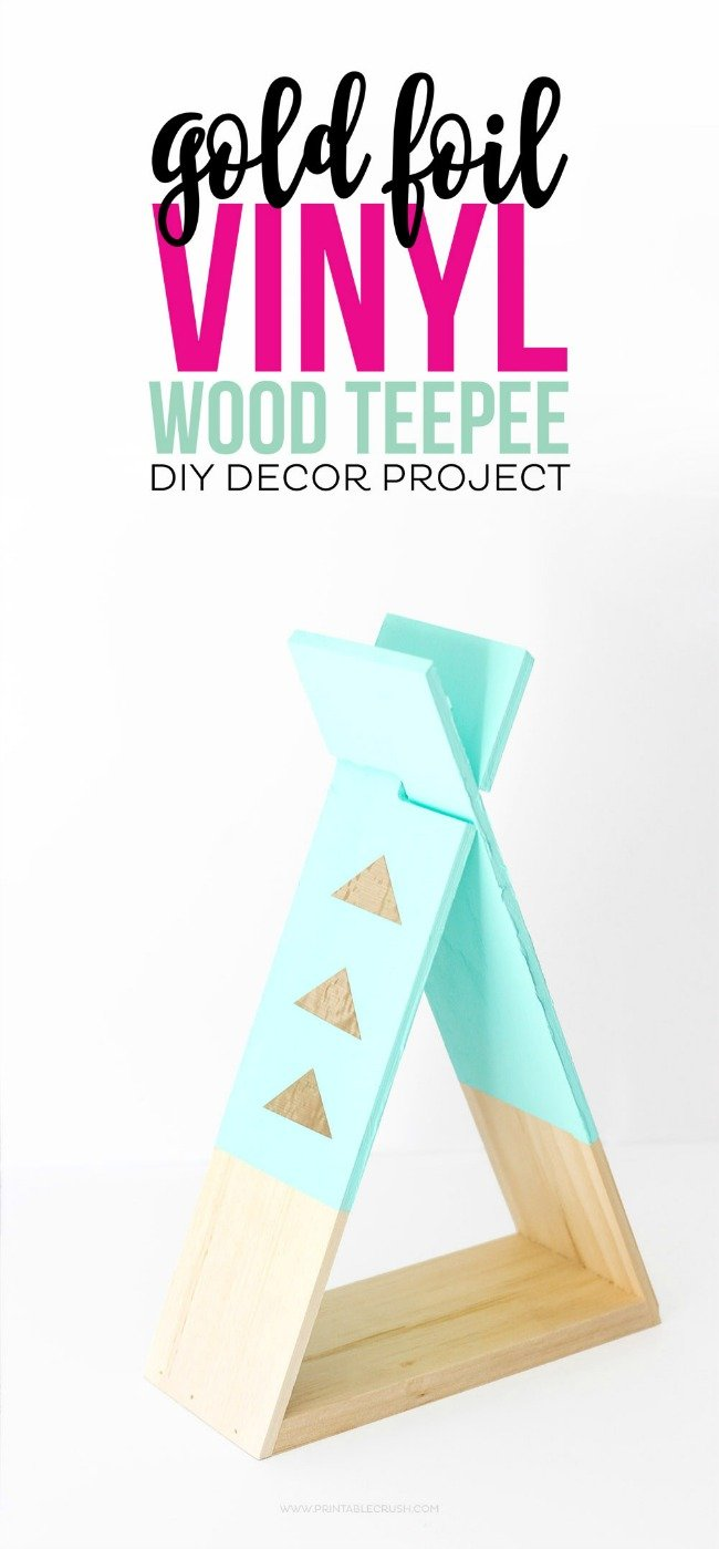 two pieces of teal wood in the shape of a teepee