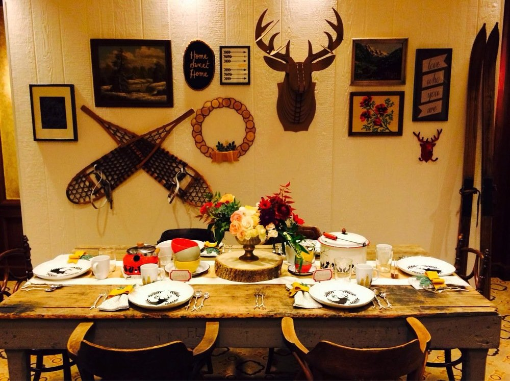 cabin room with deer heads on the wall