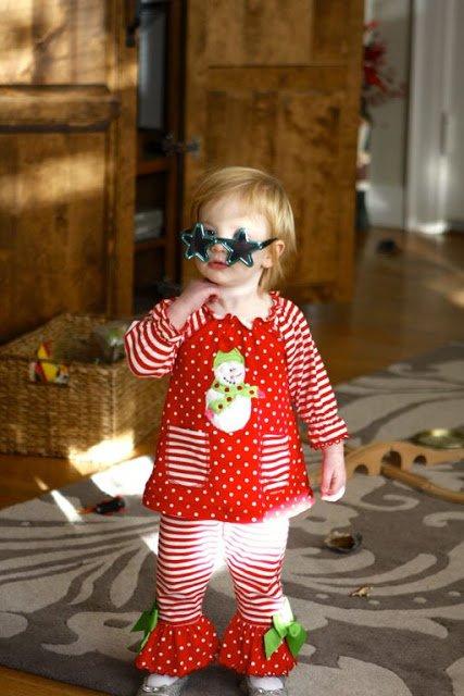 little girl wearing star sunglasses