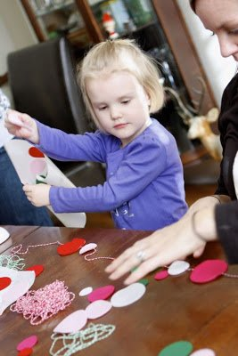 woman and girl creating a felt garland