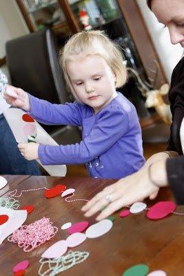 woman and girl creating a felt garland