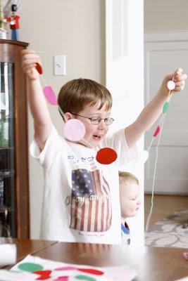 boy holding felt garland