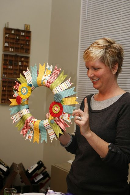 Beth Kingston hold paper wreath