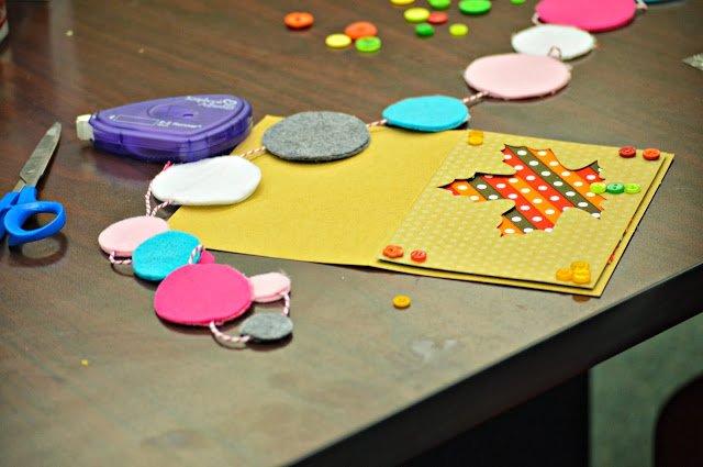 handmade card and felt garland on table