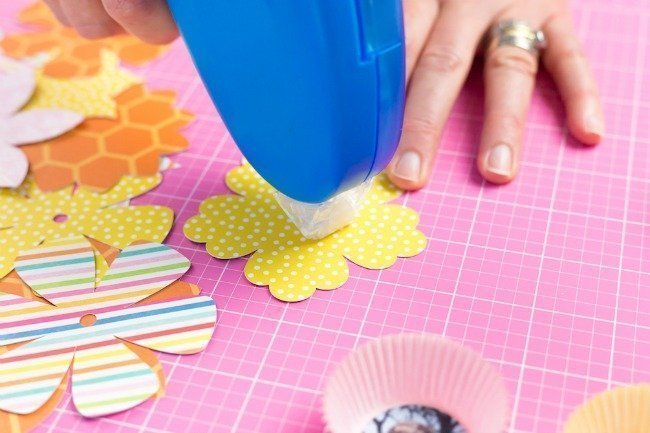 apply adhesive to center of flower die cuts