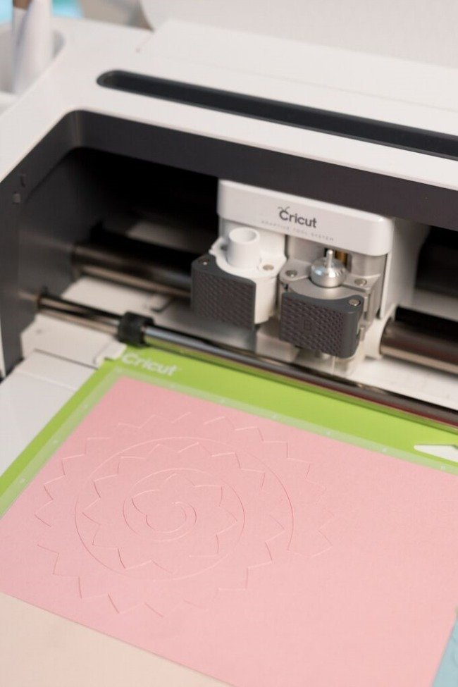 Cricut machine cutting flowers