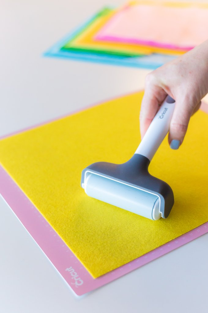 use the Cricut Brayer to smooth the felt on to your fabric mat